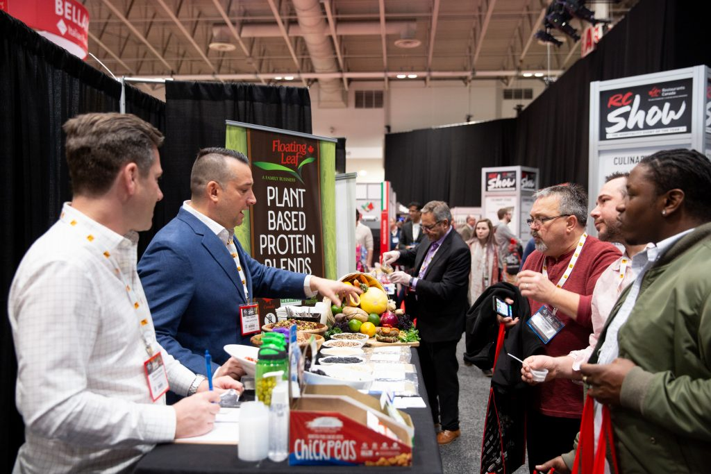 Attendees tasting products at  RC Show